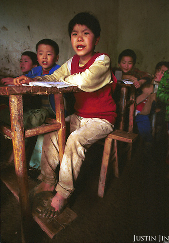 Eleven-year-old Chen attends school at her teacher's house in Yilong, an impoverished village in China's southwestern Sichuan province...Most children in Yilong leave school around 11-13 to help their parents farm...Picture taken April 99.Copyright Justin Jin