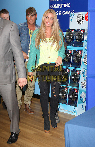Katie Price (Jordan).signing copies of her new magazine 'Katie' at WH Smith, Milton Keynes, Bucks, UK,.September 17th 2011.full length green  cardigan yellow top  black ripped jeans  ankle boots .CAP/JIL.©Jill Mayhew/Capital Pictures