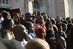 Mourners exit St. Sabina's following the funeral of Tyshawn Lee, 9, who was shot multiple times while playing basketball in an alley on November 2, 2015, in Chicago, Illinois on November 10, 2015. Police allege the killing was a retaliatory gang hit which would mark a new turn in Chicago's gang wars.