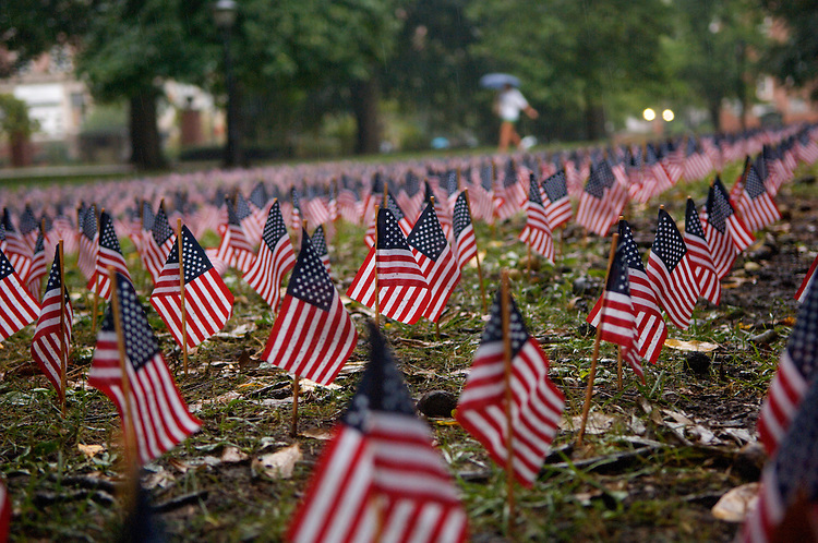 183729/11/07: Thousands of flags on the West Portico commemorate the Sept 11th tragedy. Steven Rounthwaite, of Athens plays Amazing Grace