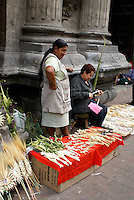 Women making and selling Palm Sunday crosses outside a church in Mexico City