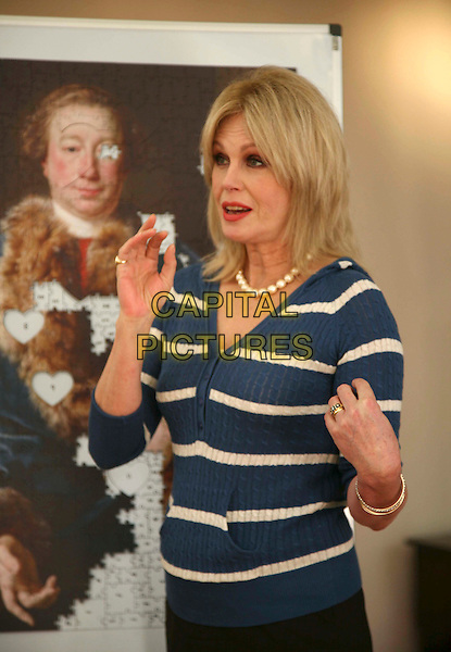 JOANNA LUMLEY.adds the first piece to a jigsaw puzzle of John Rolle Walter by Pompeo Batoni.  Pieces of the jigsaw are being sold to visitors at the Olympia International Art & Antiques Fair to raise £15,000 towards the purchase of the painting for the Royal Albert Memorial Museum..London, 4th June 2008..half length blue and white striped cardigan red lipstick hands.CAP/DS.©Dudley Smith/Capital Pictures
