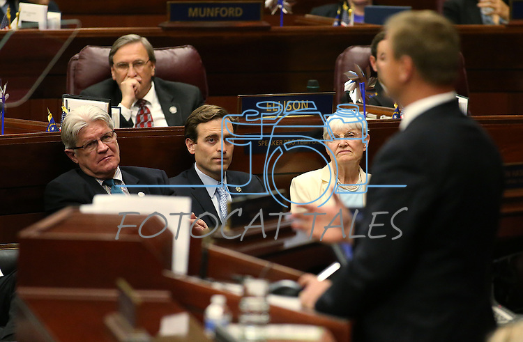 Nevada Controller Ron Knect, left, Attorney General Adam Laxalt and his communications director Patty Cafferata listen as Republican U.S. Sen. Dean Heller speaks to the Nevada Legislature in Carson City, Nev., on Monday, April 6, 2015. <br /> Photo by Cathleen Allison