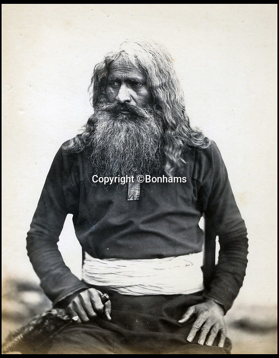 BNPS.co.uk (01202)558833Pic:  Bonhams/BNPS<br /> <br /> An Indian fakir or holy man.<br /> <br /> Amazing portraits of Maharajas looking their most resplendent have come to light 150 years later.<br /> <br /> The snaps reveal the remarkably elaborate outfits worn by members of the Indian ruling class in the mid 19th century.<br /> <br /> One striking photo shows a Maharaja on horseback holding a long spear, while another is of an Indian ruler in his finery on his throne.<br /> <br /> There are also photos of Nepalese ladies of the court in spectacular dresses and high ranking British officials.