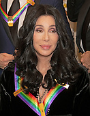 Cher, one of the recipients of the 41st Annual Kennedy Center Honors as she poses for a group photo following a dinner hosted by United States Deputy Secretary of State John J. Sullivan in their honor at the US Department of State in Washington, D.C. on Saturday, December 1, 2018.  The 2018 honorees are: singer and actress Cher; composer and pianist Philip Glass; Country music entertainer Reba McEntire; and jazz saxophonist and composer Wayne Shorter. This year, the co-creators of Hamilton,­ writer and actor Lin-Manuel Miranda; director Thomas Kail; choreographer Andy Blankenbuehler; and music director Alex Lacamoire will receive a unique Kennedy Center Honors as trailblazing creators of a transformative work that defies category.<br /> Credit: Ron Sachs / Pool via CNP