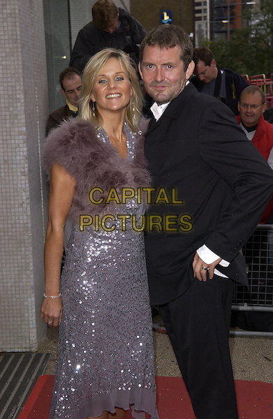 LINDA BARKER & GUEST.Arrivals At The Avenue To The Stars 50 Years Of ITV event held at LWT studios,.London, 18th September 2005.half length purple fake fur wrap spsrkly sequin dress.Ref: FIN.www.capitalpictures.com.sales@capitalpictures.com.© Capital Pictures.