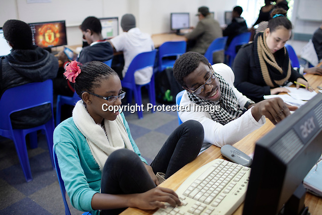 MBABANE, SWAZILAND - AUGUST 2: Students interact in a computer room at Waterford Kamhlaba United World College of Southern Africa, a secondary school on August 2, 2013 in Mbabane, Swaziland. The school was funded in 1963 with 16 students during South Africa's Apartheid years. It's a multiracial school with 600 students with about 50 countries around the world. The majority are African students. (Photo by: Per-Anders Pettersson)