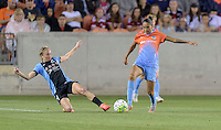 Alyssa Mautz (4) of the Chicago Red Stars slides in to strip the ball from Poliana (2) of the Houston Dash in the first half on Saturday, April 16, 2016 at BBVA Compass Stadium in Houston Texas.