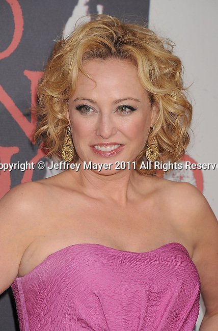 "HOLLYWOOD, CA - MARCH 07: Virginia Madsen  arrives to the ""Red Riding Hood"" Los Angeles Premiere at Grauman's Chinese Theatre on March 7, 2011 in Hollywood, California."