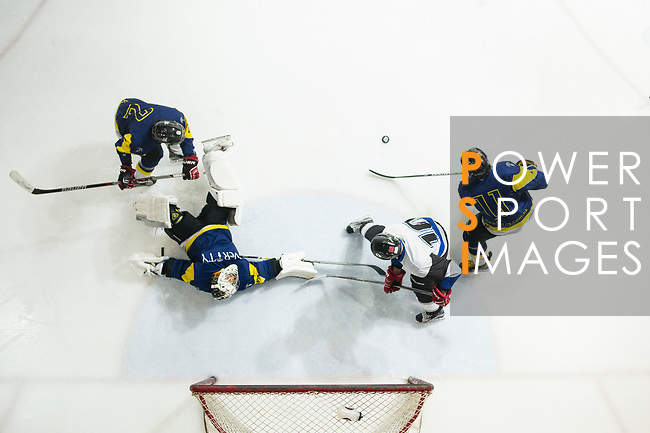 Verity Team Goalkeeper #33 Sam Wong falls down, while his teammate #11 Ryan Wong hits the puck away during the match Gaggia Empire vs Verity, a match part of the Principal Standard League on 07 March 2017 in Mega Ice, Hong Kong, China. Photo by Marcio Rodrigo Machado / Power Sport Images