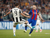 Football Soccer: UEFA Champions UEFA Champions League quarter final first leg Juventus-Barcellona, Juventus stadium, Turin, Italy, April 11, 2017. <br /> Juventus Gonzalo Higuain (l) in action with Andr&eacute;s Iniesta (r) during the Uefa Champions League football match between Juventus and Barcelona at the Juventus stadium, on April 11 ,2017.<br /> UPDATE IMAGES PRESS/Isabella Bonotto