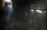 Defendants of Egyptian Muslim Brotherhood sit behind the defendants cage as they attend their trial along with Egyptian ousted president Mohammed Morsi (unseen), on the outskirts of the capital Cairo, on February 26, 2017. Photo by Egyptian President Office