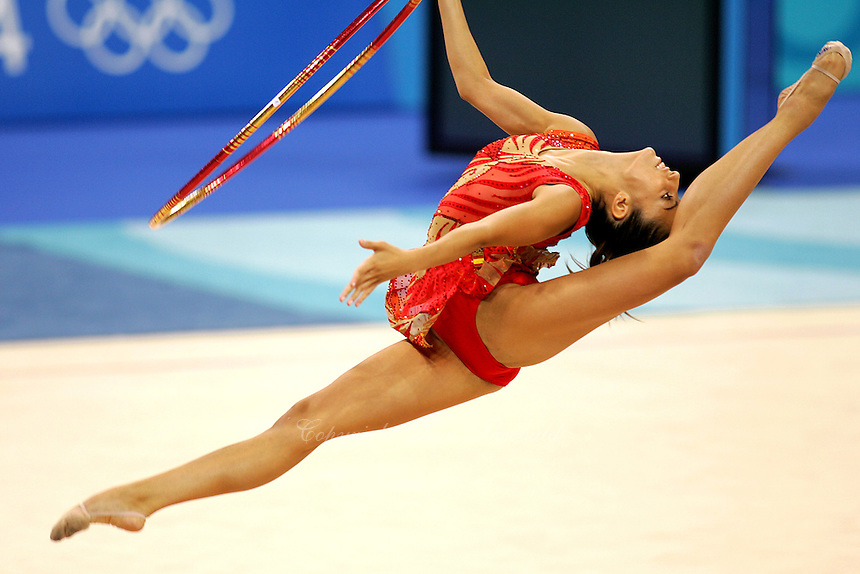 August 26, 2004; Athens, Greece; Rhythmic gymnastics star ALMUDENA CID of Spain split leaps with hoop in All-Around competition at 2004 Athens Olympics. Almudena Cid has made history by being the only rhythmic gymnast ever to make 3 Olympic finals.<br />