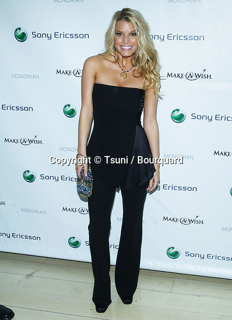 """Jessica Simpson arriving at the  """" SHOOT FOR THE STARS MAKE A WISH FOUNDATION in Los Angeles. November 13, 2003"""
