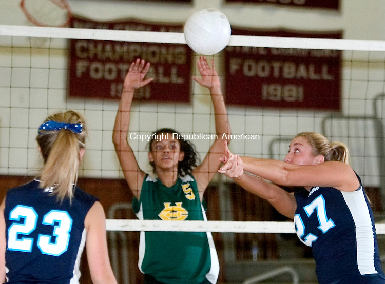 NAUGATUCK, CT. 30 October 2007-103007SV11--#27 Megan Jones of Ansonia returns a ball over the net as #5 Savannah Holness of Holy Cross defends during NVL Volleyball tournament action at Naugatuck High School in Naugatuck Tuesday. at left, #23 Jessi Mengold of Ansonia.<br /> Steven Valenti Republican-American