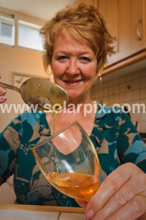 **ALL ROUND EXCLUSIVE PICTURES FROM SOLARPIX.COM**.**WORLDWIDE SYNDICATION RIGHTS**.Linda Faulkner, who developed her own potion made from apple cider vinegar to relieve her arthritis pain, pictured at her home in Javier, near Alicante, Spain. 6 February 2010.This pic: Linda Faulkner..JOB REF: 10621 BHY       DATE: 06_02_2010.**MUST CREDIT SOLARPIX.COM OR DOUBLE FEE WILL BE CHARGED**.**MUST AGREE FEE BEFORE ONLINE USAGE**.**CALL US ON: +34 952 811 768 or LOW RATE FROM UK 0844 617 7637**