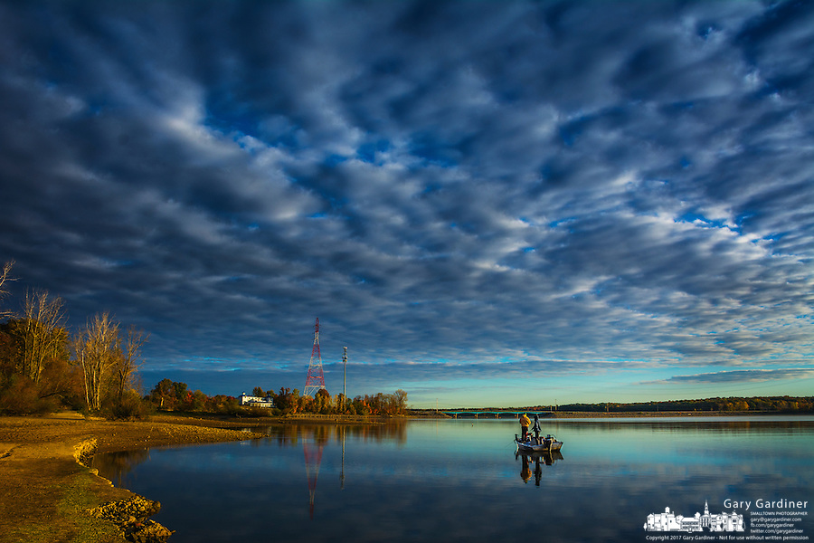 A pair of fisherman troll along the shoreline of Hoover Reservoir in early morning.