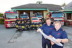 Mark Brady and  Paudie Mangan look at the plans for the new extention to Killarney fire station which is badly needed for the equipment they have