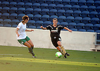 FC Gold Pride forward Tiffeny Milbrett (15) cuts the ball back to maneuver around Red Stars defender Whitney Engen (9).  The FC Gold Pride defeated the Chicago Red Stars 3-2 at Toyota Park in Bridgeview, IL on August 22, 2010