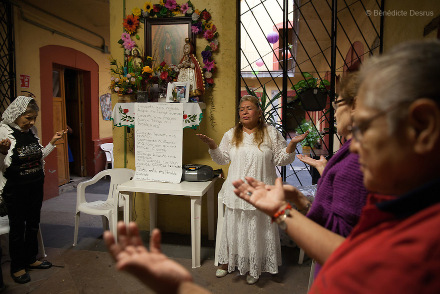 Juanita, a resident of Casa Xochiquetzal, conducts her weekly prayer service at the shelter in Mexico City, Mexico on June 8, 2016. Casa Xochiquetzal is a shelter for elderly sex workers in Mexico City. It gives the women refuge, food, health services, a space to learn about their human rights and courses to help them rediscover their self-confidence and deal with traumatic aspects of their lives. Casa Xochiquetzal provides a space to age with dignity for a group of vulnerable women who are often invisible to society at large. It is the only such shelter existing in Latin America. Photo by Bénédicte Desrus