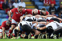 The Canada front row of Doug Wooldridge, Ray Barkwill and Hubert Buydens pack down for a scrum. Rugby World Cup Pool D match between Canada and Romania on October 6, 2015 at Leicester City Stadium in Leicester, England. Photo by: Patrick Khachfe / Onside Images