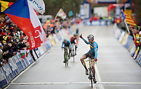 Yannick Peeters (BEL) finishing 2nd is happy for his countryman Jelle Schuermans (BEL) holding off the dutch Joris Nieuwenhuis (NLD) for 3rd place, making the Junior Men podium all belgian<br /> <br /> 2014 UCI cyclo-cross World Championships