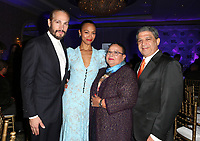 LOS ANGELES, CA - NOVEMBER 8: Marco Perego, Zoe Saldana, Dagoberto Galan, Asalia Nazario, at the Eva Longoria Foundation Dinner Gala honoring Zoe Saldana and Gina Rodriguez at The Four Seasons Beverly Hills in Los Angeles, California on November 8, 2018. Credit: Faye Sadou/MediaPunch