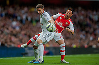 LONDON, ENGLAND - MAY 11 Angel Rangel of Swansea City  battles for the ball with Santi Cazorla of Arsenal  during  to the Premier League match between Arsenal and Swansea City at Emirates Stadium on May 11, 2015 in London, England.  (Photo by Athena Pictures/Getty Images)