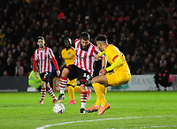 Lincoln City's Michael Bostwick vies for possession with Northampton Town's Shaun McWilliams<br /> <br /> Photographer Andrew Vaughan/CameraSport<br /> <br /> Emirates FA Cup First Round - Lincoln City v Northampton Town - Saturday 10th November 2018 - Sincil Bank - Lincoln<br />  <br /> World Copyright © 2018 CameraSport. All rights reserved. 43 Linden Ave. Countesthorpe. Leicester. England. LE8 5PG - Tel: +44 (0) 116 277 4147 - admin@camerasport.com - www.camerasport.com