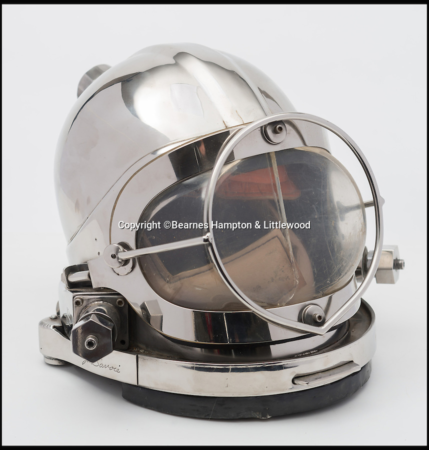 BNPS.co.uk (01202 558833)<br /> Pic: BHandI/BNPS<br /> <br /> A mixed gas stainless steel diving helmet.<br /> <br /> A British couple's lifetime hobby of deep sea diving is set to make them a breathtaking £500,000 when they sell one of the world's finest collection of vintage diving helmets.<br /> <br /> Anthony and Yvonne Pardoe amassed over 150 heavyweight copper helmets worn by divers during the early days of underwater excavation.<br /> <br /> Weighing about 55lbs, the dome-shaped helmets bolted onto a copper collar of a diving suit and had a hose attached to the rear to provide air supply from the surface.<br /> <br /> They are being sold in Devon next month.