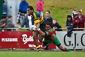 Sio Petelo tackles David Raikuna. Counties Manukau McNamara Cup Premier Club Rugby final between Pukekohe andWaiuku, held at Bayer Growers Stadium, on Saturday July 17th. Waiuku won 25 - 20.
