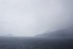 Fog covers the horizon in the Faroe Islands.