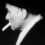 blurred image of a man with a cigarette