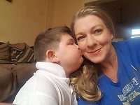 "Pictured: Seth Burke with his mum Lisa<br /> Re: A brave schoolboy had his wish come true when he sang a duet with his favourite signing star Dolly Parton.  <br /> Seth Burke, nine, always listens to Queen of Country Dolly when he's in hospital having treatment for Duchenne's muscular dystrophy.<br /> Doting parents Lisa and John took him on a Caribbean cruise where the crew heard about his love for Dolly. <br /> The family was called up on stage one night and heard a familiar Tennessee drawl say: ""Hi Seth!""<br /> The schoolboy couldn't believe his eyes when he turned to see Dolly on a huge TV screen.<br /> Seth, of Grangetown, Cardiff, was diagnosed with Duchenne Muscular Dystrophy when he was a baby."