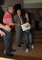 """NWA Democrat-Gazette/FLIP PUTTHOFF <br /> ESL CELEBRATION<br /> Bentonville High School student Emmily (cq) Sanchez gets a certificate and congratulations from school board president Travis Riggs (left) and Superintendent Mike Poore at the """"Exit Celebration"""" held Wednesday Sept. 16 2015 to recognize students who completed the school's English as a second language program. Thirty-one students received certificates of completion, said Ginger Mayes, English language development specialist for the Bentonville school district. Goals of the program include having students graduate bi-lingual or multi-lingual and be leaders in the school and community."""
