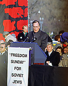 "United States Vice President George H.W. Bush speaks at the ""Campaign to the Summit"", a march on Washington, D.C. supporting freedom for Jews living in the Soviet Union, on Sunday, December 6, 1987.  200,000 people marched to focus attention on the repression of Soviet Jewry, was scheduled a day before United States President Ronald Reagan and Soviet President Mikhail Gorbachev began a 2 day summit in Washington where they signed the Intermediate Range Nuclear Forces (INF) Treaty.  Seated directly behind the Vice President is US Representative Jack Kemp (Republican of New York).<br /> Credit: Ron Sachs / CNP"