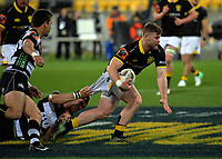 Andrew Wells tries to escape Hugh Renton's tackle during the Mitre 10 Cup rugby union match between Wellington Lions and Hawkes Bay Magpies at Westpac Stadium, Wellington, New Zealand on Wednesday, 6 September 2017. Photo: Dave Lintott / lintottphoto.co.nz