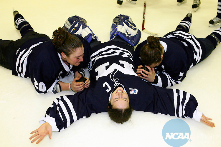 18 Mar 2006. Middlebury (Vt) College hockey players L-R Gloria Velez,#20, goalie Kate Kogut, and Liz Yale-Loehr, #7 lay on the ice in silly jubilation after their team won first place in the NCAA Womens Division lll Championship Saturday night at SUNY Plattsburgh in upstate New York.The  Middlebury women defeated Plattsburgh State 3-1 in the championship game. The game was held in the Stafford Arena. Nancie Battaglia/NCAA Photos