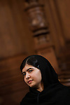 Malala Yousafzai, 16, eduction campaigner, receives an honorary degree of Master of Arts from the University of Edinburgh at the inaugural meeting of the Global Citizenship Commission. Malala survived an assassination attempt by members of the Taliban in October 2012. Edinburgh 19 Oct 2013© copyright photo by Tina Norris
