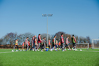 SWANSEA, WALES - FEBRUARY 17:  The Swansea City Squad warm up before training on February 17, 2015 in Swansea, Wales.  (Photo by Athena Pictures )