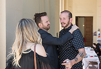 From left, Lauren Paul and Aaron Paul greet their friend, Tedx speaker Jedidiah Jenkins, outside Choi Auditorium. The two came to see Jenkins' talk.<br /> Occidental College's second TEDx event, Choi Auditorium, April 2, 2016. Featuring talks on sustainability and global development by speakers that included five students, a faculty member and seven external speakers.<br /> (Photo by Marc Campos, Occidental College Photographer)