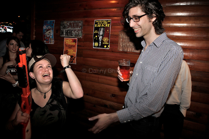 Lisa Roberts, 25, left, reacts to losing a game as Richard Flynn, 33, steps up for his turn at The Black Bear Lodge in Manhattan, which hosted an official Big Buck Party on Thursday April, 28, 2011. Fans of the popular hunting arcade game were invited to test their skill against other Big Buck Hunter fans to compete for prizes, enter to win raffle merchandise and meet Big Buck Girls...Danny Ghitis for The New York Times