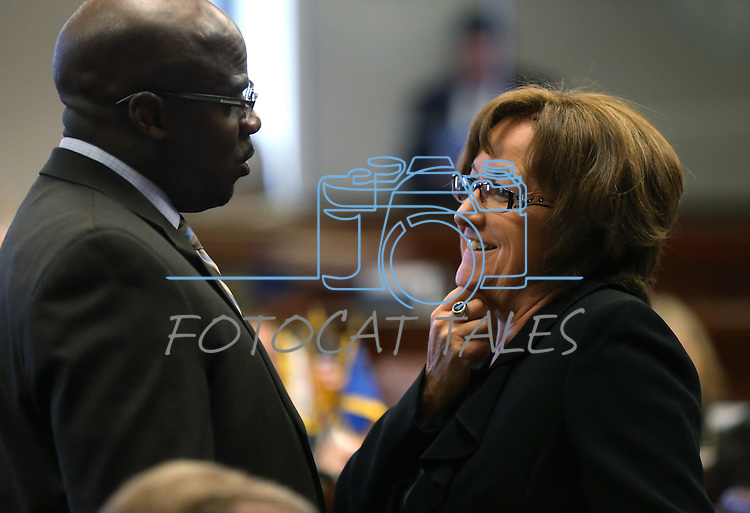 Nevada Senate Democratas Kelvin Atkinson and Debbie Smith talk on the Senate floor at the Nevada Legislature in Carson City, Nev., on Monday, March 4, 2013..Photo by Cathleen Allison