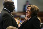 Nevada Senate Democratas Kelvin Atkinson and Debbie Smith talk on the Senate floor at the Nevada Legislature in Carson City, Nev., on Monday, March 4, 2013..Photo by Cathleen Allison