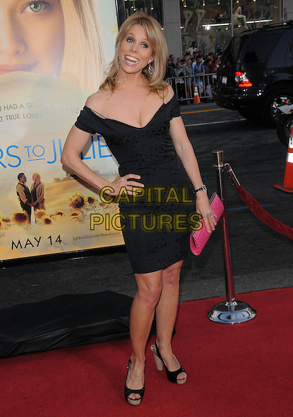 "CHERYL HINES.L.A. Premiere of ""Letters to Juliet"" held at The Grauman's Chinese Theatre in Hollywood, California, USA..May 11th, 2010.full length black off the shoulder dress hand on hips pink clutch bag platform peep toe shoes cleavage.CAP/RKE/DVS.©DVS/RockinExposures/Capital Pictures."
