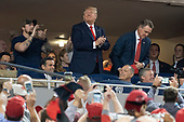 United States President Donald J. Trump acknowledges the crowd during a moment to salute the military during game five of the World Series at Nationals Park in Washington DC on October 27, 2019.  The Washington Nationals and Houston Astros are tied at two games going into tonight's game. Those pictured with the president include United States Representative John Ratcliffe (Republican of Texas), United States Representative Andy Biggs (Republican of Arizona), and United States Representative Mark Meadows (Republican of North Carolina).<br /> Credit: Chris Kleponis / Pool via CNP