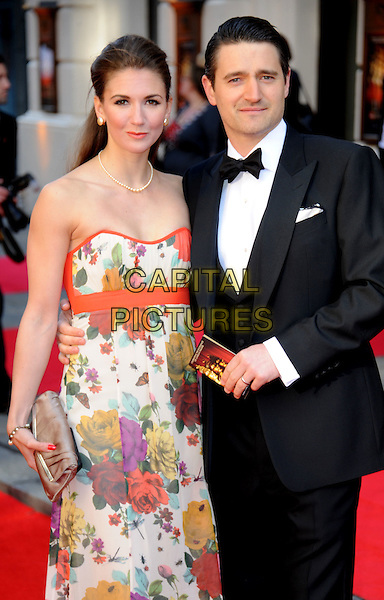 Summer Strallen & Tom Chambers.The Olivier Awards 2012, Royal Opera House, Covent Garden, London, England..April 15th, 2012.half length tuxedo black white strapless orange  necklace pearl .CAP/WIZ.© Wizard/Capital Pictures.