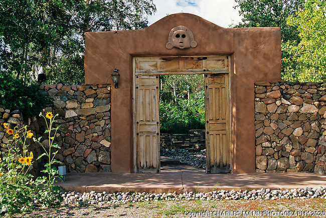 The gardens of Santa Fe,New Mexico, offer a constant suppply of delightful surprises and artful delights. Actor and bon vivant Mel Fillini created a dramatic garden after the style of Luis Barragan, the Mexican architect.