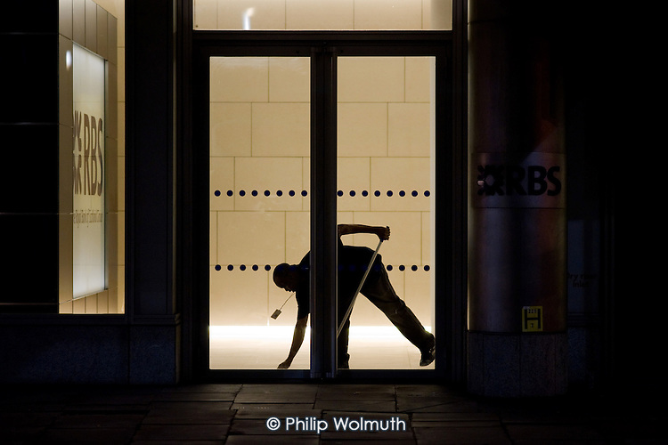 Cleaner on a night shift at Royal Bank of Scotland offices in the City of London