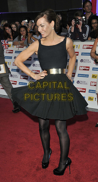 Tara Palmer Tomkinson.'The Daily Mirror's Pride Of Britain Awards 2011' at Grosvenor House Hotel, London, England..3rd October 2011.full length black dress tights belt gold hand on hip tpt sleeveless spinning twirling profile .CAP/CAN.©Can Nguyen/Capital Pictures.